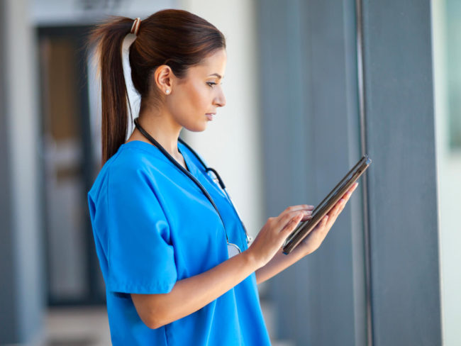 nurse studying for the nclex on a tablet
