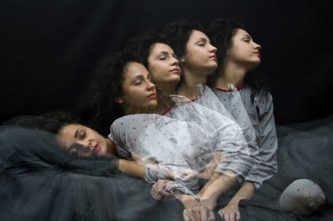 Multiple exposure of sleeping girl getting up or sleepwalking