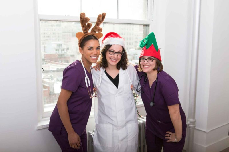 female medical residents dressed in chrsitmas costumes resident gift guide