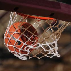 Basketball Going Through A Basketball Hoop